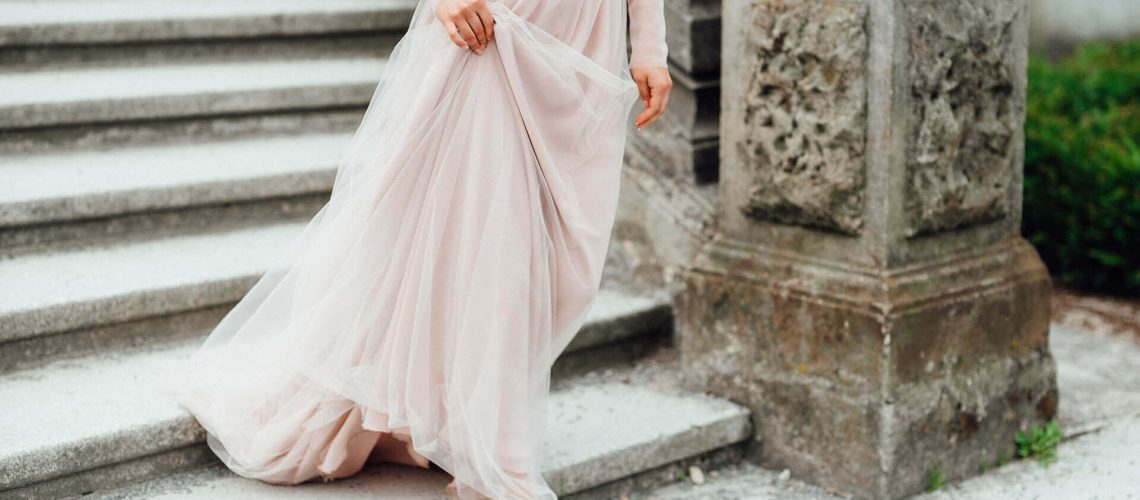 a-girl-in-a-light-pink-dress-against-the-backgroun-AKYVBF9-1.jpg